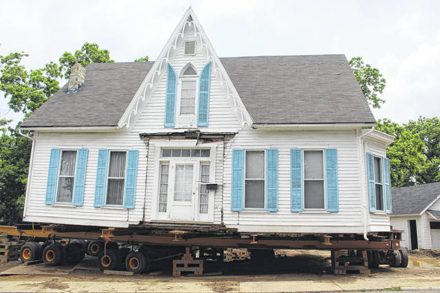The historical Robinson-Pavey home on the wagon that will carry it to its final spot at 1733 State Route 41 Southwest in Washington C.H.