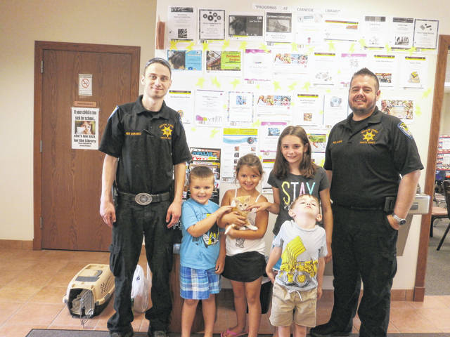 The Fayette County Humane Society visited Jeffersonville Branch Library recently. Brad Adams, humane agent and outreach education director, talked about the humane treatment of animals and dog bite prevention safety, Those attending were (pictured left to right) Nick Marando, humane agent; Jaden, Jordyn, Annabel, Sam and Brad Adams, humane agent.