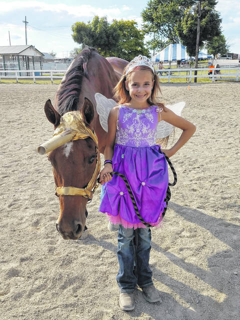 The Fayette County Junior Fair Horse Costume Contest was held on Wednesday evening at the horse arena. Chloe Gardner and Sunny dressed as a fairy princess and unicorn.