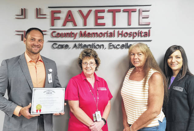 Members of the Fayette County Memorial Hospital accounting team: Trent Lemle, CFO; Kim Kember, accounts payable; Bonny Mallow, payroll coordinator; and Aubrey Webb, accounting leader.