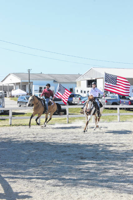 "Anya Matthews and Garren Walker participated in a freestyle horse reining demonstration Wednesday morning to the song ""Party In The U.S.A."" by Miley Cyrus. The freestyle demonstration had several requirements, including lead changes and spins for the duo to complete."
