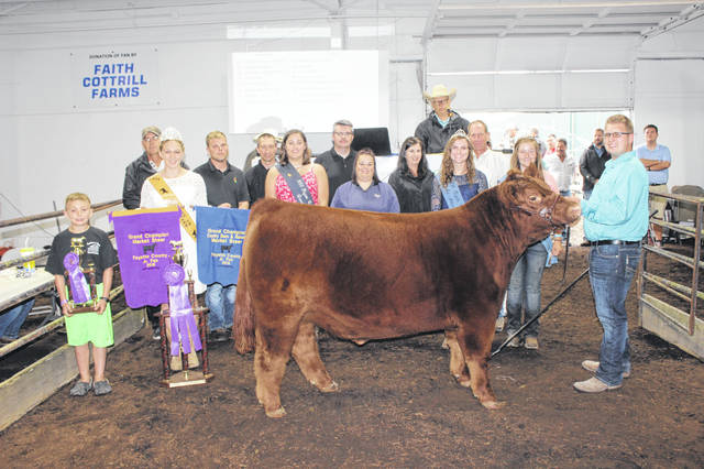 Quinton Waits' grand champion steer sold for $5,000 at Friday's Fayette County Beef Steer Sale. Quinton is the son of Kristina and Daryl Waits. Waits is pictured with buyers and fair royalty, from left to right: (front row) Ashton Bain (friend), Beef Queen Victoria Waits, Fair Queen Jordan Bernard, Amy Mick of Kroger, Fair Attendant Haley Copas, Fair Attendant Victoria Schappacher, (back row) Mike Rife of Rife Farms, Josh Hagler of Seed Consultants, Keith Tooill of McDonald's Restaurants, Lisa Duff of Duff Farms, and Jim Gusweiler of Gusweiler.