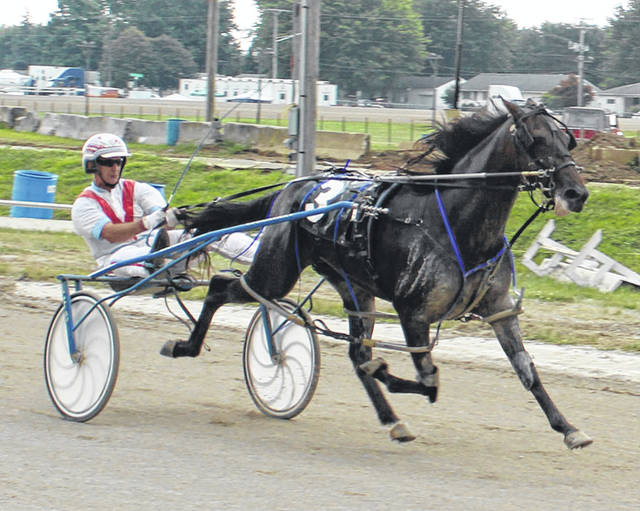 Petacular Rock, driven by Jack Dailey, crosses the line to win the D.E. Mossbarger Fayette County Classic Saturday, July 21, 2018 at the fair.