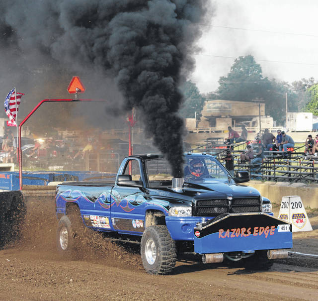 Jeremy Straley of London, Ohio drives the Razor's Edge Dodge in the 8,000-lb. Pro Stock Diesel 4 x 4 truck category at the Fayette County Fair Tuesday, July 17, 2018.