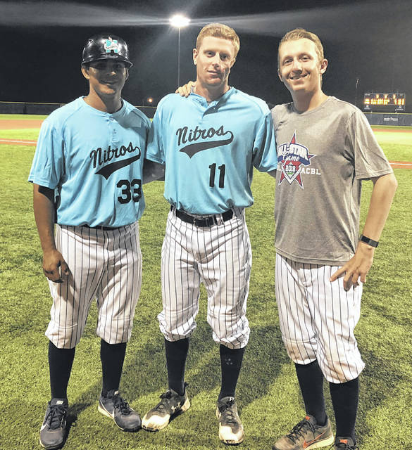 Tucker Hughes, middle, is flanked by Nitros pitching coach Pete Horner (left) and hitting coach Sebastian Guillen.