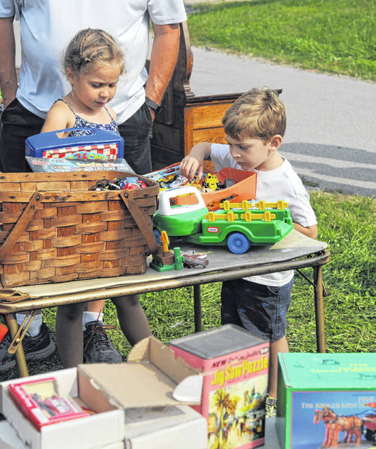 Small shoppers look through an assortment of toys at Scott Antique Markets in Washington Court House.
