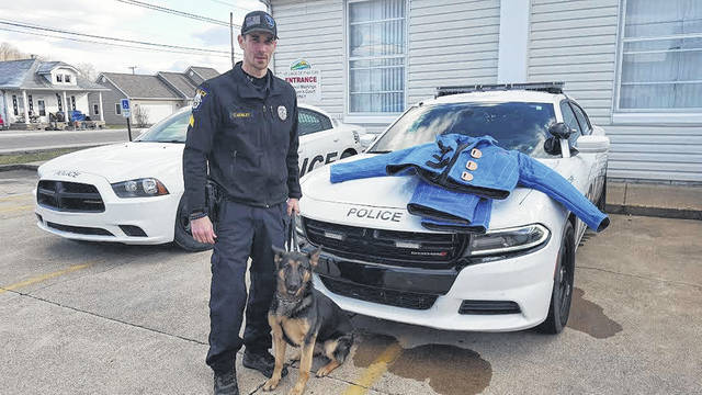 "Christopher Mosley poses with his K-9, ""Lana,"" while a sergeant for the Piketon Police Department."