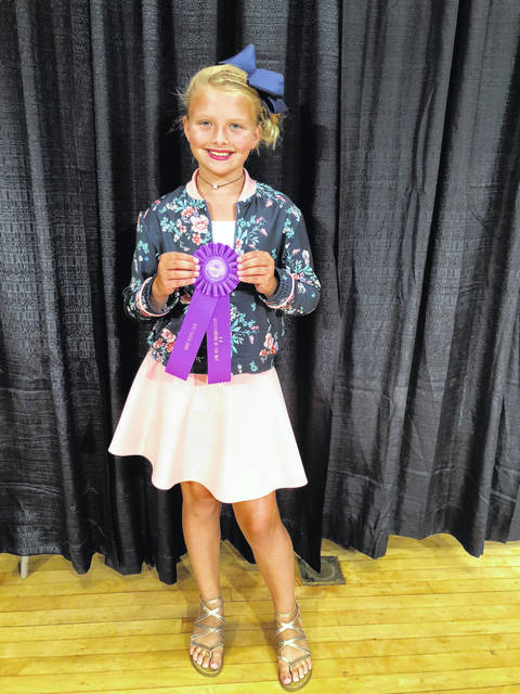 """Cali Kirkpatrick won an """"Outstanding of the Day"""" in the 4-H Sew Fun Sewing Category at the 2018 Ohio Star Fair in August. Cali's project was judged against other 4-H members across the state on construction, the seven clues of fashion, and her project book. She is a member of All-N-One 4–H club and a fifth grade student at Miami Trace Elementary. Cali is the 10-year old-daughter of Brent and Sarah Kirkpatrick."""