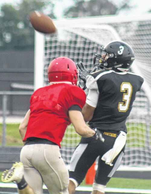 Miami Trace's Dalton Mayer (3) hauls in a touchdown pass from Tyler Taylor during a scrimmage against Westfall Friday, Aug. 17, 2018. The scrimmage ended in a 20-20 tie. Jaden LeBeau also scored a touchdown for the Panthers in the final tune-up before Circleville visits MTHS next Friday night at 7 p.m.