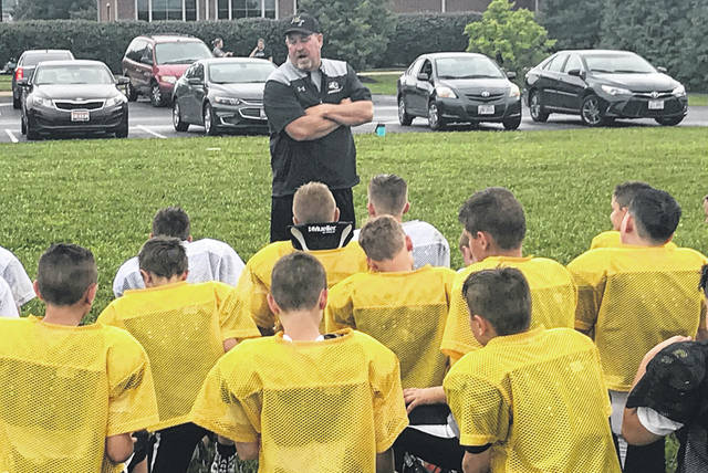 Miami Trace Panthers head coach Jerry Williams speaks to the Miami Trace Youth Football Program's fifth and sixth grade teams Wednesday, Aug. 15, 2018 on two important rules of Miami Trace Football: Keep good grades in school and have utmost respect in the classroom.