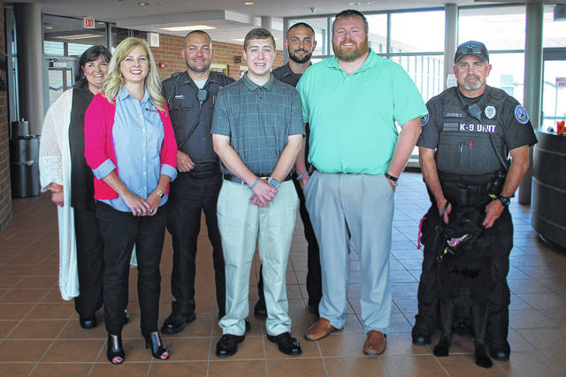 "Attending the presentation of the City of Washington Court House Police Department Scholarship are (l-r) Jessica Wise, Ph.D., SSCC Dean of Instructional Operations and Director of Fayette Campus; Nicole Roades, Ph.D., SSCC Vice President of Academic Affairs, Patrolman Mike Warnecke, scholarship recipient Trevor Phillips; Patrolman Alex George; Detective Jonathan Sever; and K-9 Handler Charles Hughes with ""Edo."""