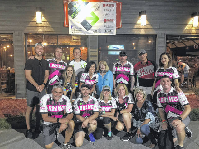 The local team of riders and organizers at Pelotonia: Top Row - Conner Eckles; Richard Penwell; Shelby Miller; Kaleb Eckles; Susan Eckles; Leslie Darif; Milan Hansen; Kate Darif. Bottom Row - David Darif; Trey Tompkins; Angie Curtis; Kellie Chambers; Cheryl Fisher; Eric Darif. Not Pictured - Mark Fisher; Don Pop; Mike Callahan; Tony Merrit; Matt Pettit.