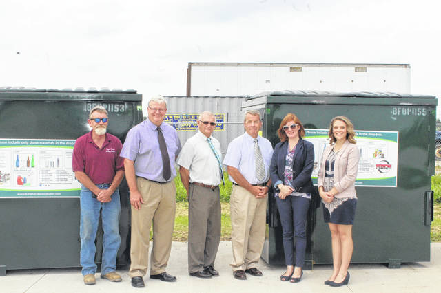 Landfill Manager Danny Springer, County Commissioner Dan Dean, County Commissioner Jack DeWeese, County Commissioner Tony Anderson, District Director Erica Tucker, and Assistant District Director Lauren Grooms pose in front of the new recycling bins in their new location.