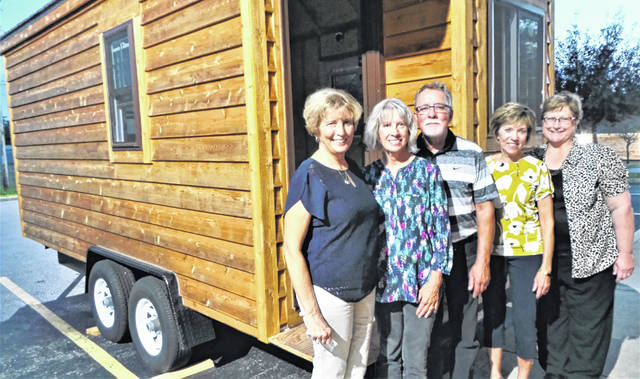 """The first dinner meeting of the new school year occurred in mid-September for Fayette County's Delta Kappa Gamma, the female teachers' honorary; and the program was a different one: Dr. Pam Anderson spoke about her """"hygge house,"""" the Danish version of a """"tiny house."""" One of her goals was to learn how to build a house; and she not only showed phase-by-phase photos of its construction, but also invited DKG members to come outside the St. Colman Parish Center and view the tiny house in person, with questions answered by her husband. Pictured are (from left) DKG President Carol Waddle, Dr. Pam Anderson, Dr. Peter Torgerson, and DKG members Jo Anderson and Carolyn Puckett."""