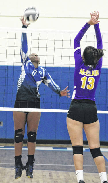 Washington's Amya Haithcock (8) goes up for the kill during a Frontier Athletic Conference match against McClain Thursday, Sept. 13, 2018 at Washington High School.