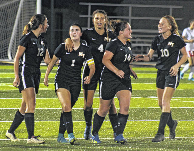 Miami Trace senior Becca Ratliff (1) walks back up the field after scoring the first goal during a Frontier Athletic Conference match at home against Jackson Thursday, Sept. 13, 2018. Joining Ratliff are (l-r); Krissy Ison (12), Jenna Griffith (4), Aubrey Schwartz (14) and Magarah Bloom (10). Ratliff scored the hat trick (three goals) in a 3-0 victory over the Iron Ladies.