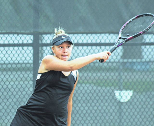 Cameron Bucher follows through on her forehand shot for Miami Trace during a Frontier Athletic Conference match against Hillsboro on the courts at Miami Trace Tuesday, Sept. 11, 2018l.