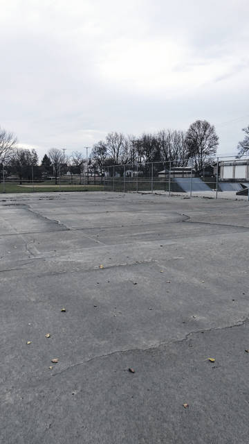 A Leadership Fayette group has resurfaced old tennis courts at Eyman Park to meet requirements for new pickleball courts. A grand opening will be held this Saturday at 10 a.m. Pictured is a before and after the resurfacing of the courts.