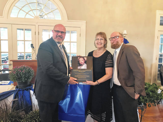 Washington Court House City Schools Academic Hall of Fame inducted two new members Monday. The first — inducted posthumously — was Dennis J. Denen, a 1964 graduate of Washington High School. Pictured is Dennis' widow Laura Denen, her son, and WCHCS Superintendent Tom Bailey.