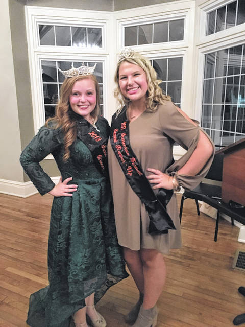 Scarecrow Queen Brooklynn Stanley poses with Abbi Pettit who served on the court last year and crowned the queen and runners-up this year.