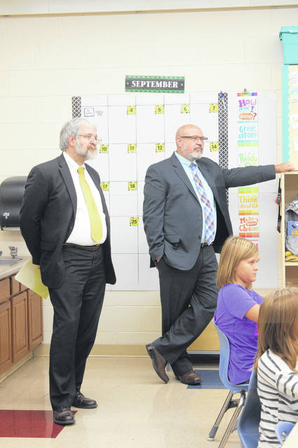 DeMaria and Washington Court House City Schools Superintendent Tom Bailey sit in on a class at Belle Aire Intermediate.