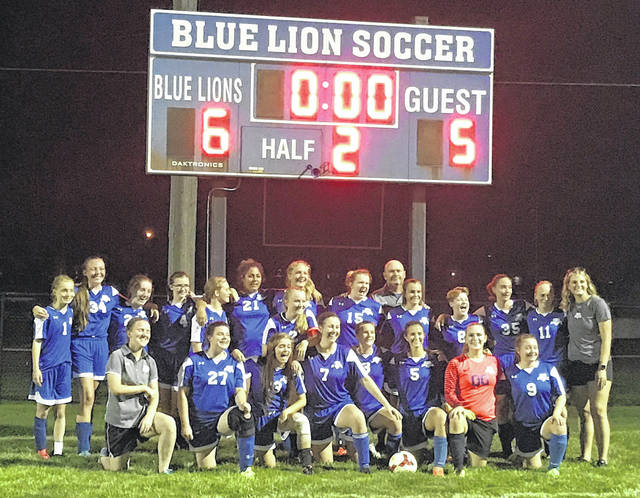 The Washington Lady Blue Lions celebrate breaking a long losing streak with a 6-5 win over the McClain Lady Tigers Thursday, Sept. 13, 2018 at Washington High School.