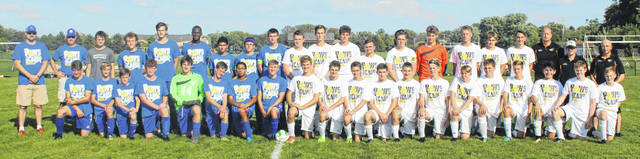 Washington Blue Lions (on the left) and Miami Trace Panthers (at right) gathered on the field prior to the match Tuesday, Sept. 18, 2018. The cause was cancer awareness.