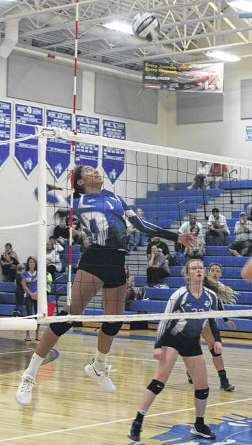 Washington's Rayana Burns (1) goes up for the kill during a non-conference match at home against Madison Plains Wednesday, Sept. 5, 2018. Also pictured for Washington is Halli Wall.