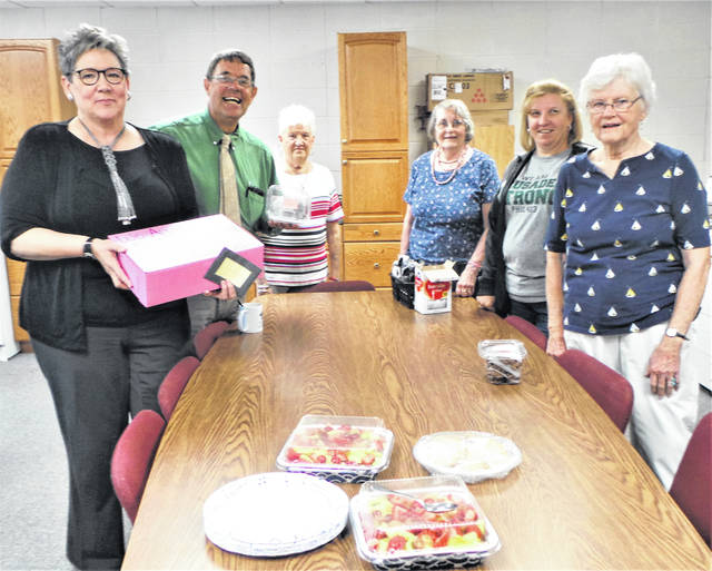 """The local Altrusa club's Finance Committee surprised staff at Fayette Christian School with a """"Random Act of Kindness"""": sweet treats just in time for lunch. Each year, the five standing committees of Altrusa International of Washington C.H. chose a month to perform a RAK somewhere in the community, and September was the month chosen by Chair Anne Quinn's group. It turned out that Tuesday was a good day to pump up energy, as the Crusaders were to host a volleyball match that very evening. Pictured are Anne Quinn, Pastor Tony Garren, Joyce Huntington, Sally Begin, FCS secretary Tonya Pollock and Mary Sue Spengler. Other Altrusans on the Finance Committee are Nancy Bennett, Norita Craycraft and Vicki Staffan."""