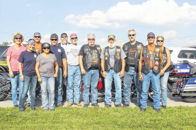 Members of American Legion Post 25 rode in the escort of the traveling Vietnam Memorial wall from the Fayette County Fairgrounds to Chillicothe. From left to right: Mary Miley, Tracy Thomas, Lisa Minzler, Dave Leisure, Rod Allen, Paul McKenzie, Will Dunstan, Mike Hall, Brian Finney, John King, Bonny Millow, and Mike Mallow.