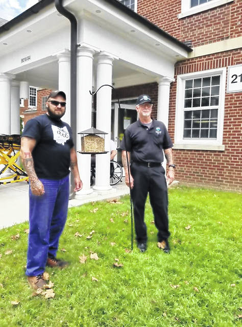 Shawn Nichols and Sam Johnson stand beside the bird feeder they donated to Freedom's Path. Johnson said the veterans like to sit outside and watch the birds.