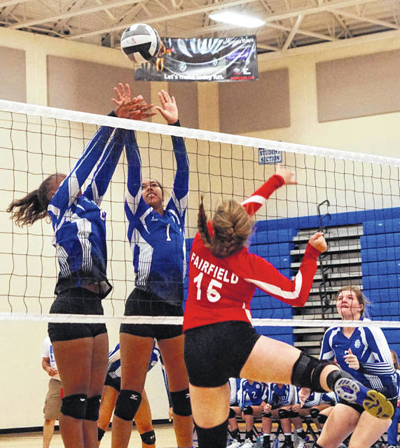 Washington's Amya Haithcock (left) and Rayana Burns combine to block a shot during a non-conference match against Fairfield Monday, Oct. 8, 2018. Also pictured for the Lady Lions, at right, is Maddy Jenkins.