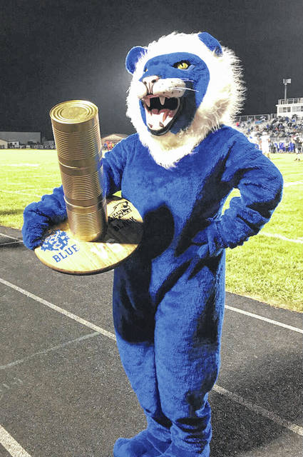 """George Washington,"" the WHS mascot, with the Battle of the Black & Blue can food drive trophy."