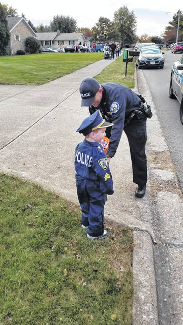 The Record-Herald recently asked for submissions from residents to show off their Beggars' Night costume. Braeden Feasel, dressed as a 3-year-old police officer, meets with a Washington Police Department Officer who was passing out candy.