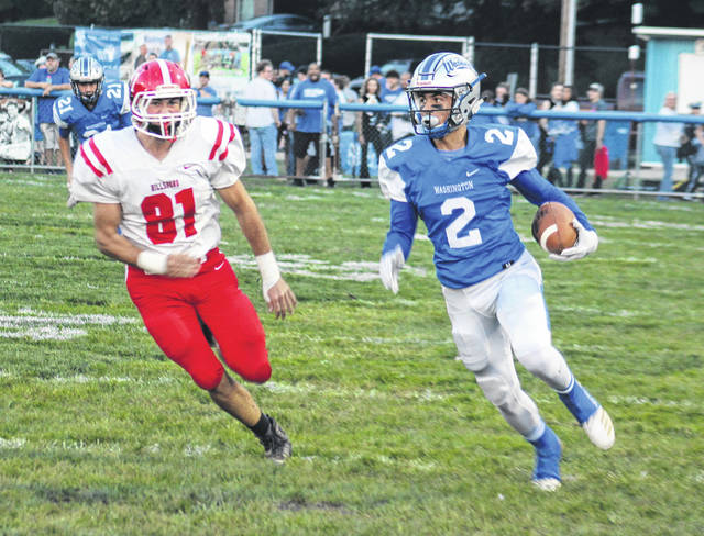 Dillon Steward (2) carries the ball for the Washington Blue Lions during a Frontier Athletic Conference game against Hillsboro at Gardner Park Friday, Oct. 5, 2018. Pictured for the Indians is Luke Middleton.
