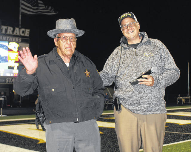 The Fayette County Sheriff Auxiliary was formed in 1962 by Sheriff Don Thompson and Chief Deputy Bob McArthur. The main purpose of the organization was to patrol and provide security at Miami Trace ball games. Special Deputy Don Campbell, at left, was in attendance at the first Miami Trace home football game and he was on duty Friday, Oct. 19, 2018. He was recognized at the end of the first quarter of the Panthers' game against Hillsboro. At right is Miami Trace High School Athletic Director Aaron Hammond, who introduced Deputy Campbell to the crowd.
