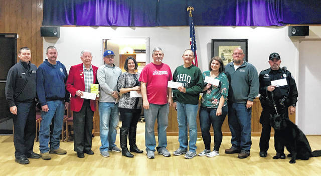Elks Lodge #129 recently made several grant money donations to worthy recipients. Pictured are exalted ruler Tyler Osborne, Dennis Noble-Est. Leading Knight, Edward Helt (dictionary project), Brandon Runk (Fayette County Special Olympics), Kristy Bowers (The Ranch of Opportunity), Gary Davis and Jon Creamer (The Well at Sunnyside), Abby Fitch (The Warehouse Youth Center), Scott Mullen - chairman of trustees, officer Charlie Hughes and K-9 officer Edo (Washington Police Department).