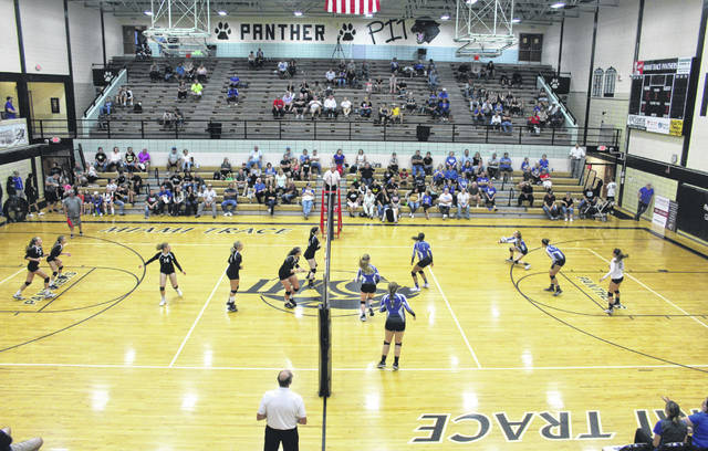 The Miami Trace varsity volleyball team (left) hosts Washington for the final high school varsity sporting event in the Panther Pit on the campus of Miami Trace High School Thursday, Oct. 4, 2018.