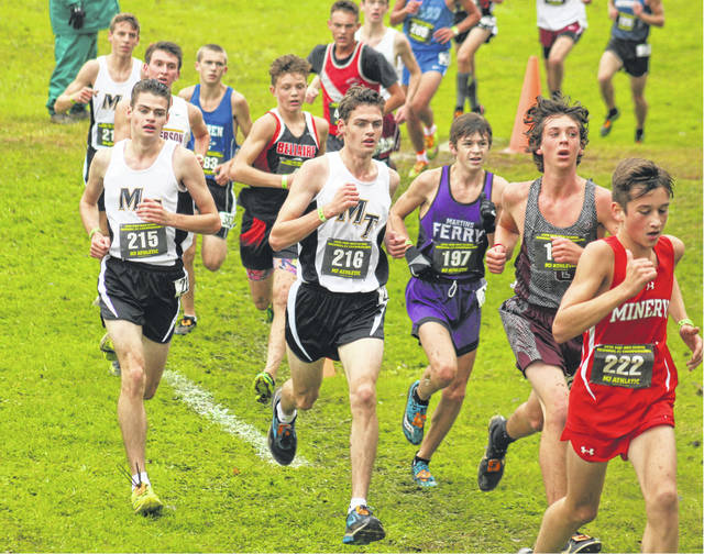 Henry DeBruin (215) and Simon DeBruin (216) of Miami Trace head for a hill on the course at the Division II Regional cross country meet at Pickerington North High School Saturday, Oct. 27, 2018. Pictured in behind Henry DeBruin is teammate Bo Little.