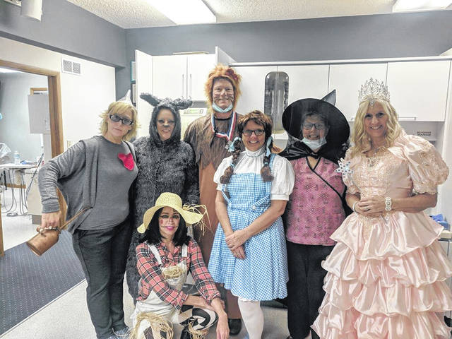 The Dr. Wall Family Dentistry staff was in the Halloween spirit on Wednesday with their Wizard of Oz costumes. From left to right standing are: Betsy Anders, Jessica Robinson, Dr. Greg Wall, Jodi Klontz, Kay Hill, Chris Scott, and kneeling is Missy Brown.