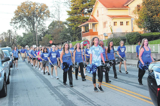 Washington High School held its Homecoming Pep Rally and Parade on Wednesday evening with fall sports athletes, coaches and the Blue Lion Marching Band taking part in the evening festivities. Pictured are members of the band as they turned onto Circle Avenue near Gardner Park.