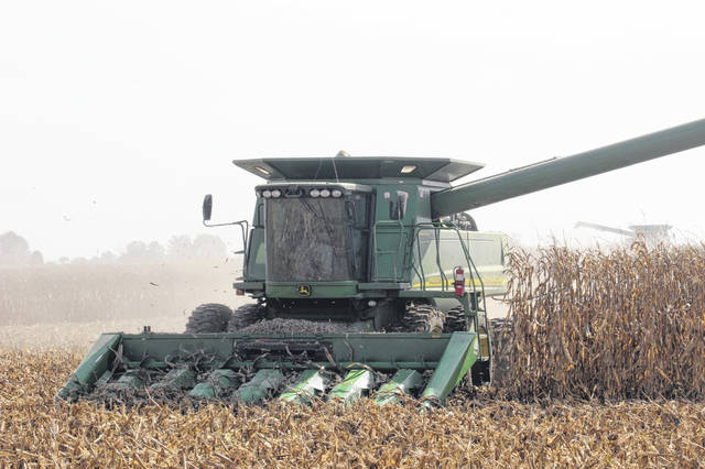 Harvest season is underway in Fayette County with machinery visible in fields all over the community as farmers work to gather crops. Farmers on Bloomingburg New Holland Road near the Miami Trace Local Schools' campus worked diligently Tuesday afternoon to clear the field.