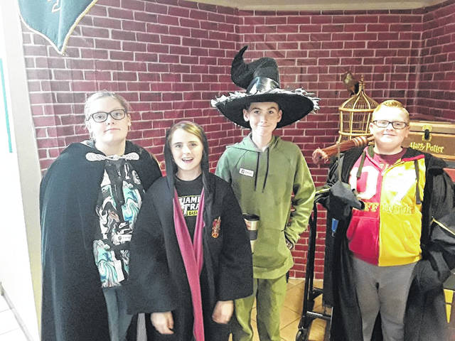 Jenna, Kamika, Robbie and Jonah show their Potter pride after solving the escape room's mysteries.