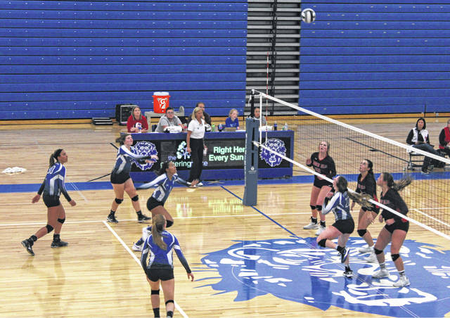 Halli Wall (at net) sets the ball for Washington during a Division II Sectional semifinal match against Logan Elm Wednesday, Oct. 17, 2018 at Washington High School. Also pictured for Washington (l-r); are Hannah Haithcock, Maddy Jenkins, Rayana Burns and Tabby Woods.