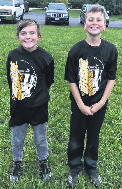 Miami Trace Youth Football Program Players of the Week for games played Oct. 13 and 14, 2018 are (l-r); Kooper Hicks, Defensive Player of the Week and Grant Guess, Offensive Player of the Week. In games played Oct. 13 and 14, the Miami Trace Varsity Gold team remained undefeated with a 15-12 win over East Clinton. The Varsity Black team lost to Jackson, 32-0; the J-V Black team fell to Jackson, 29-0; the Varsity White squad lost to Washington, 16-0 and the J-V White team fell to Washington, 26-0.