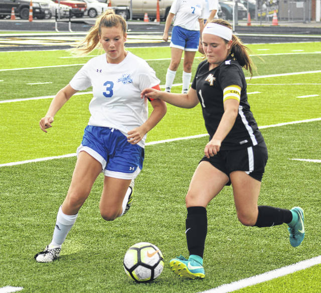 A pair of seniors, Mackenzie Shaffer, left, of Washington and Becca Ratliff of Miami Trace, look to control the ball during a Frontier Athletic Conference match at Miami Trace High School Thursday, Oct. 4, 2018.