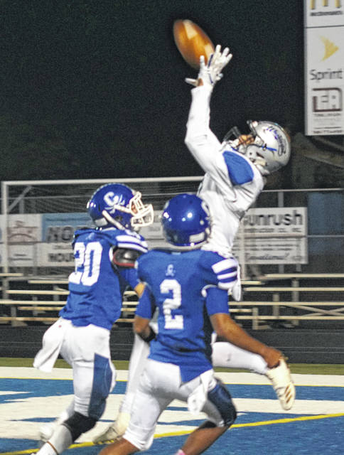 Washington's Omar Porter leaps up to make the touchdown catch over Chillicothe's McKellan Lee (20) and Adrian Beverly (2) Friday, Oct. 19, 2018 during a Frontier Athletic Conference game at Chillicothe.