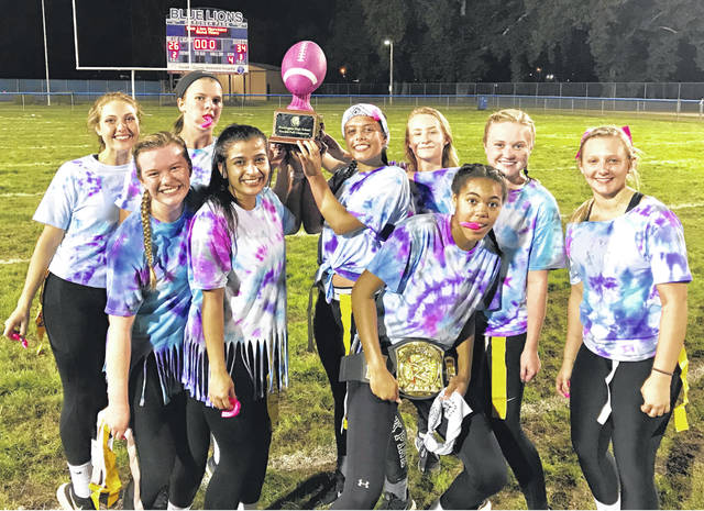 The Washington High School Junior Class is the 2018 Homecoming Powderpuff Champions. The Class of 2020 is undefeated at Gardner Park. With an all-time record of 4-0, these Lady Lions beat the Class of 2019 once again in the championship to earn the pink football. (l-r); Mackenzie Truex, Halli Wall, Shawna Conger, Kara Vohra, Jordan Kearns, Jaedynn Duell, Rayana Burns, Abby Tackage and Aria Marting. The final score was 34-26.