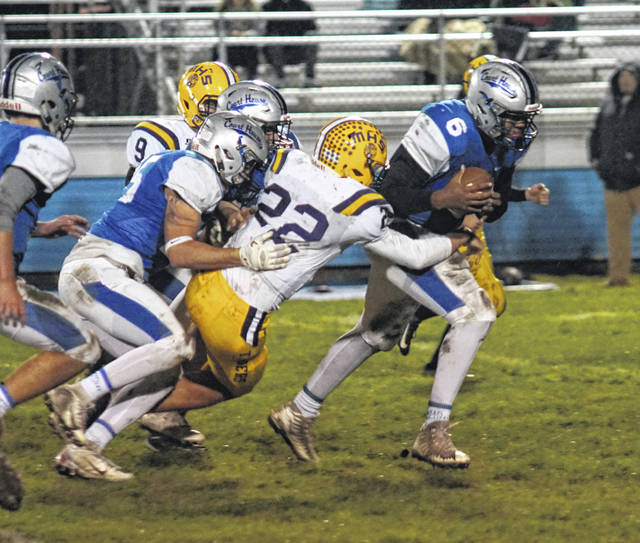 Richard Burns (6) returns a recovered fumble for the Washington Blue Lions during a Frontier Athletic Conference game against the McClain Tigers at Gardner Park Friday, Oct. 12, 2018.