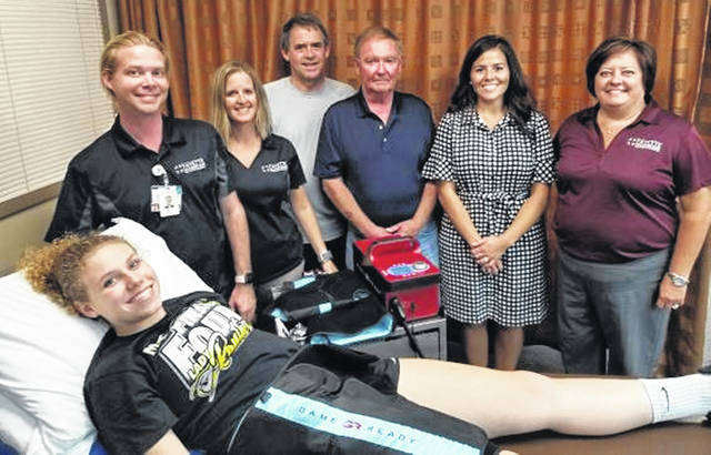 Grace Bapst (front) demonstrates the Game Ready therapy equipment. From left: Skip Lewis, FCMH Physical Therapy Assistant, Angie Curtis, FCMH Leader of Therapy, PR Marshal and Steve Simpson of Washington Shrine Club and Steph Dunham and Whitney Gentry, FCMH Foundation.